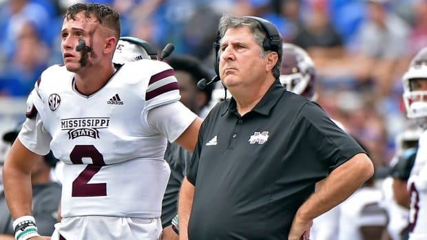 Will Rogers (2) and head coach Mike Leach (right) with Mississippi State.