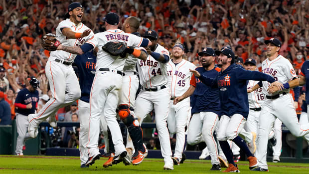 Oct 22, 2021; Houston, Texas, USA; Houston Astros relief pitcher Ryan Pressly (55) celebrates with teammates after defeating the Boston Red Sox to advance to the World Series after winning game six of the 2021 ALCS at Minute Maid Park.