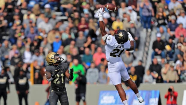 Oct 23, 2021; West Point, New York, USA; Wake Forest Demon Deacons linebacker Chase Jones (21) deflects a pass intended for Army Black Knights running back Tyrell Robinson (21) during the first half at Michie Stadium.