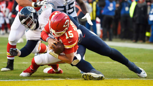 Kansas City Chiefs quarterback Patrick Mahomes (15) scores a touchdown during the second quarter of the AFC Championship game against the Tennessee Titans at Arrowhead Stadium Sunday, Jan. 19, 2020 in Kansas City, Mo. An19715