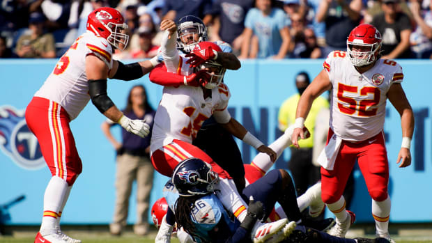 Tennessee Titans defensive end Denico Autry (96) and Tennessee Titans outside linebacker Harold Landry (58) sack Kansas City Chiefs quarterback Patrick Mahomes (15) during the second quarter at Nissan Stadium Sunday, Oct. 24, 2021 in Nashville, Tenn. Titans Chiefs 091