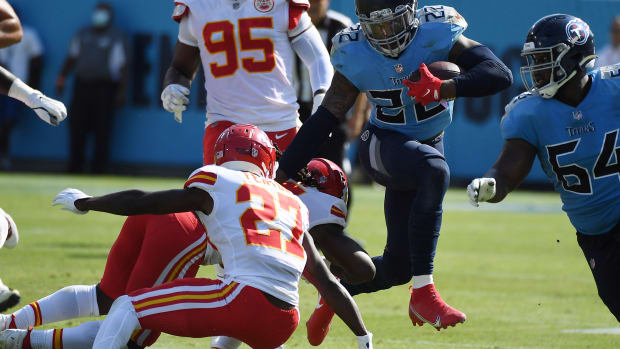 Oct 24, 2021; Nashville, Tennessee, USA; Tennessee Titans running back Derrick Henry (22) runs for a first down during the first half against the Kansas City Chiefs at Nissan Stadium. Mandatory Credit: Christopher Hanewinckel-USA TODAY Sports