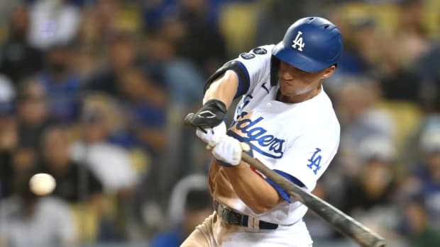 Sep 30, 2021; Los Angeles, California, USA; Los Angeles Dodgers shortstop Corey Seager (5) hits a solo home run in the seventh inning of the game against the San Diego Padres at Dodger Stadium. Mandatory Credit: Jayne Kamin-Oncea-USA TODAY Sports
