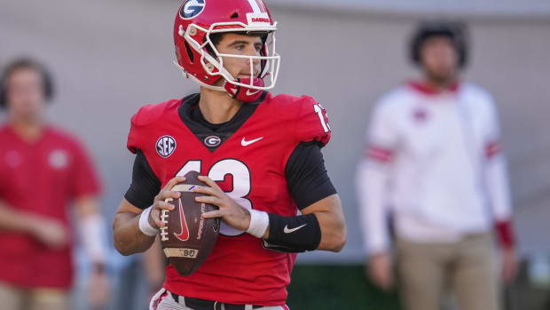 Oct 16, 2021; Athens, Georgia, USA; Georgia Bulldogs quarterback Stetson Bennett (13) looks downfield against the Kentucky Wildcats during the first half at Sanford Stadium. Mandatory Credit: Dale Zanine-USA TODAY Sports