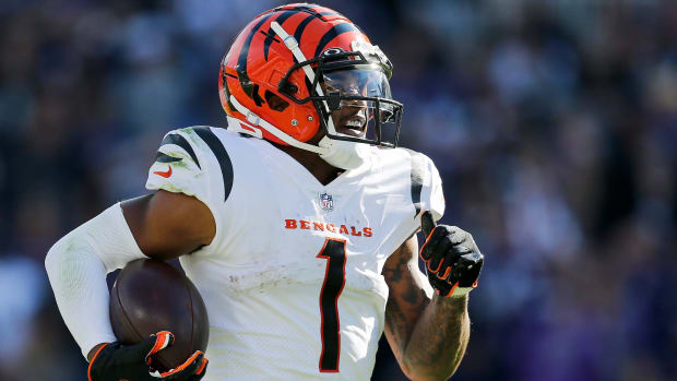 Cincinnati Bengals wide receiver Ja'Marr Chase (1) breaks tackles as he takes a reception 82 yards for a touchdown in the third quarter of the NFL Week 7 game between the Baltimore Ravens