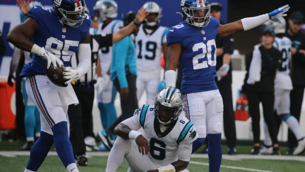 Quincy Roche and Julian Love of the Giants after sacking Carolina backup quarterback PJ Walker in the second half as the Carolina Panthers faced the New York Giants at MetLife Stadium in East Rutherford, NJ on October 24, 2021.