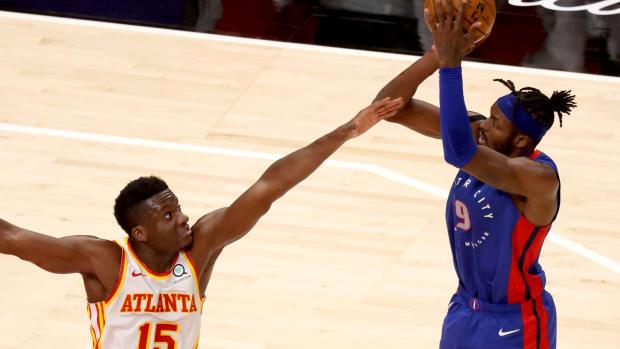Detroit Pistons forward Jerami Grant (9) attempts a shot against Atlanta Hawks center Clint Capela (15) during the second half at State Farm Arena.