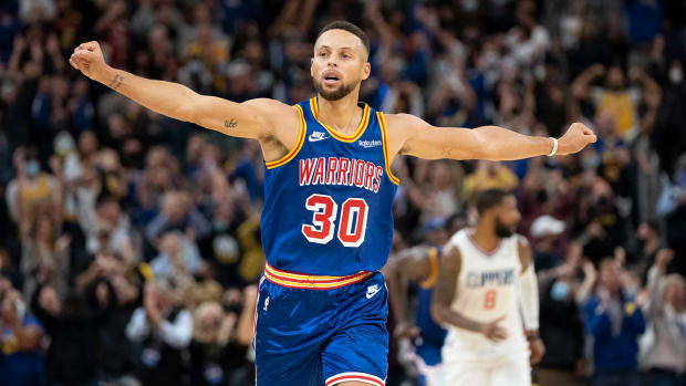 Golden State Warriors guard Stephen Curry celebrates against the LA Clippers during the fourth quarter at Chase Center.