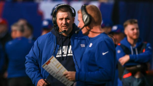 Oct 24, 2021; East Rutherford, New Jersey, USA; New York Giants head coach Joe Judge looks on with offensive coordinator Jason Garret during the second half against the Carolina Panthers at MetLife Stadium.