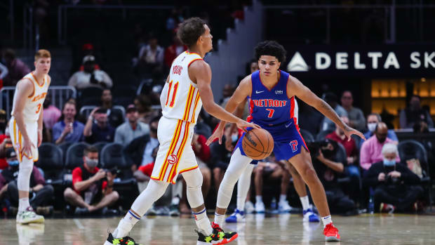 Detroit Pistons guard Killian Hayes (7) defends against Atlanta Hawks guard Trae Young (11) during the first quarter at State Farm Arena.