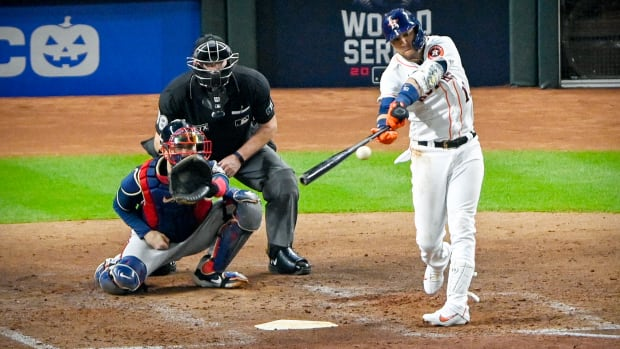 Oct 26, 2021; Houston, Texas, USA; Houston Astros first baseman Yuli Gurriel (10) hit a single against the Atlanta Braves during the fourth inning during game one of the 2021 World Series at Minute Maid Park.