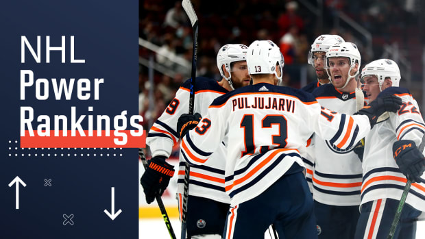 Connor McDavid celebrates a goal with his Oilers teammates.