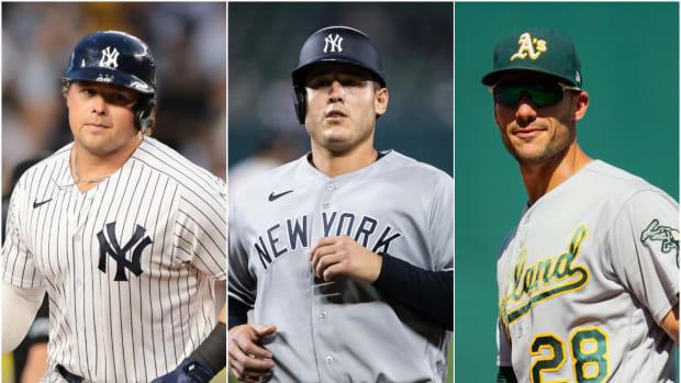 Yankees 1B Luke Voit with Anthony Rizzo and Athletics 1B Matt Olson