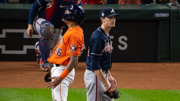 Houston Astros center fielder Jose Siri (26) celebrates as Atlanta Braves starting pitcher Max Fried (54) walks away during the second inning during game two of the 2021 World Series at Minute Maid Park.