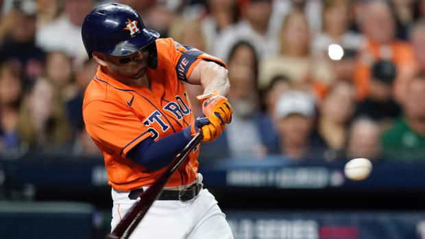Houston Astros second baseman Jose Altuve hits a double against the Atlanta Braves during the second inning in game two of the 2021 World Series at Minute Maid Park.