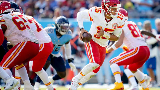 Kansas City Chiefs quarterback Patrick Mahomes (15) scrambles out of the pocket against the Titans during the third quarter at Nissan Stadium Sunday, Oct. 24, 2021 in Nashville, Tenn.