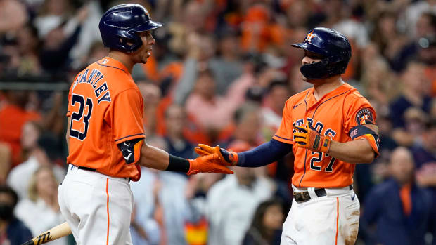 Oct 27, 2021; Houston, TX, USA; Houston Astros second baseman Jose Altuve (27) celebrates with left fielder Michael Brantley (23) after hitting a solo home run against the Atlanta Braves during the seventh inning in game two of the 2021 World Series at Minute Maid Park.