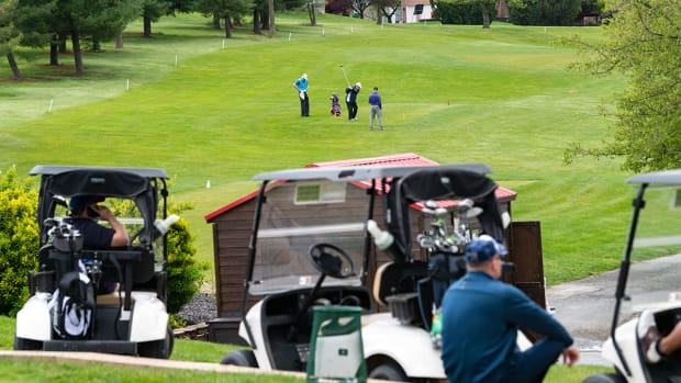 Golfers wait to tee off at a local course.