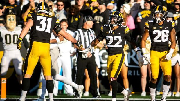 Iowa defensive back Terry Roberts (22) celebrates a stop with Iowa linebacker Jack Campbell (31) in the end zone during a NCAA Big Ten Conference football game against Purdue, Saturday, Oct. 16, 2021, at Kinnick Stadium in Iowa City, Iowa. 211016 Purdue Iowa Fb 047 Jpg