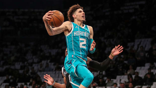 Charlotte Hornets guard LaMelo Ball goes in for a layup in the first quarter against the Brooklyn Nets.