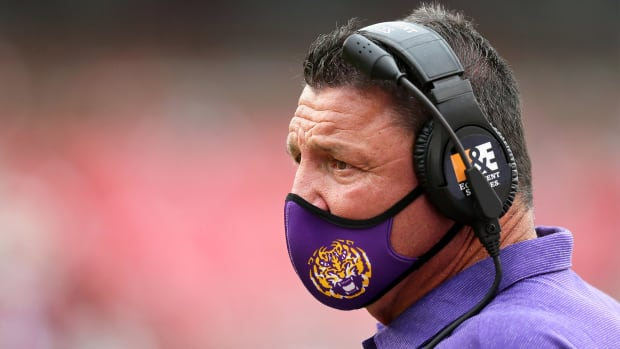 Nov 21, 2020; Fayetteville, Arkansas, USA; LSU Tigers head coach Ed Orgeron looks on during the game against the Arkansas Razorbacks at Donald W. Reynolds Razorback Stadium.