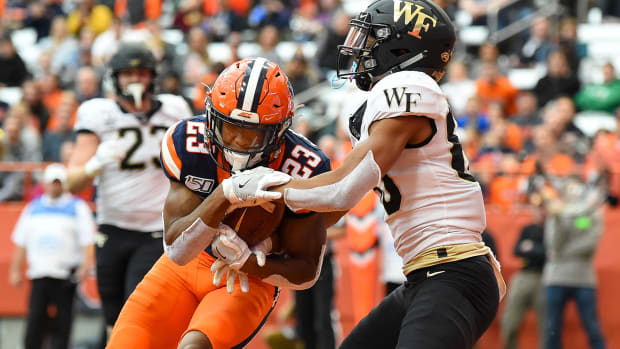 Nov 30, 2019; Syracuse, NY, USA; Syracuse Orange defensive back Ifeatu Melifonwu (23) intercepts a pass in the end zone intended for Wake Forest Demon Deacons wide receiver Waydale Jones (80) during the second quarter at the Carrier Dome. Mandatory Credit: Rich Barnes-USA TODAY Sports