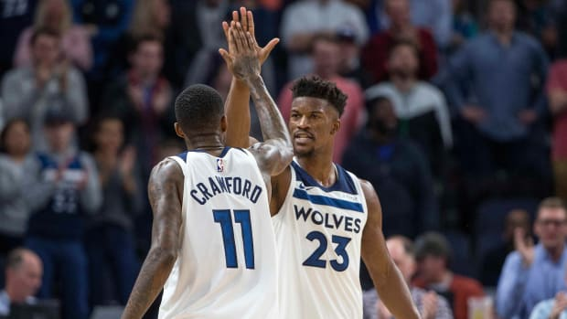Jimmy Butler and Jamal Crawford high-five as members of the Timberwolves