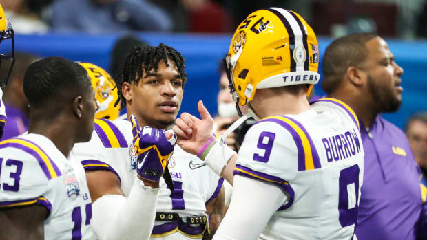 Dec 28, 2019; Atlanta, Georgia, USA; LSU Tigers wide receiver Ja'Marr Chase (1) greets quarterback Joe Burrow (9) before the 2019 Peach Bowl college football playoff semifinal game between the LSU Tigers and the Oklahoma Sooners at Mercedes-Benz Stadium. Mandatory Credit: Jason Getz-USA TODAY Sports