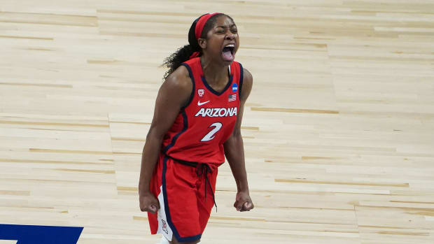 Arizona's Aari McDonald yells in celebration during an NCAA tournament game