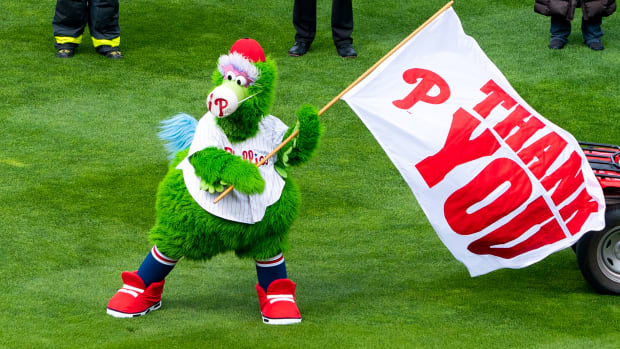 Apr 1, 2021; Philadelphia, Pennsylvania, USA; The Phillie Phanatic waves a flag thanking first responders before a game between the Philadelphia Phillies and the Atlanta Braves at Citizens Bank Park.