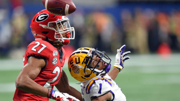 Georgia Bulldogs defensive back Eric Stokes (27) breaks up a pass intended for LSU Tigers wide receiver Ja'Marr Chase (1) during the first quarter of the the 2019 SEC Championship Game at Mercedes-Benz Stadium.