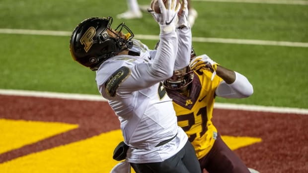 Purdue Boilermakers wide receiver Rondale Moore (4) attempts to catch a pass as Minnesota Golden Gophers defensive back Justus Harris (21) plays defense in the first half at TCF Bank Stadium.