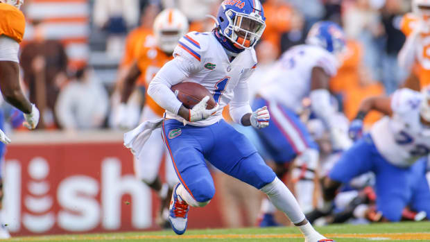 Florida Gators wide receiver Kadarius Toney (1) runs with the ball against the Tennessee Volunteers during the first half at Neyland Stadium.