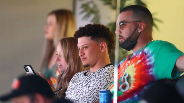 Mar 21, 2021; Phoenix, Arizona, USA; Kansas City Chiefs quarterback Patrick Mahomes (left) alongside teammate Travis Kelce in a suite during the Phoenix Suns game against the Los Angeles Lakers in the first half at Phoenix Suns Arena. Mandatory Credit: Mark J. Rebilas-USA TODAY Sports