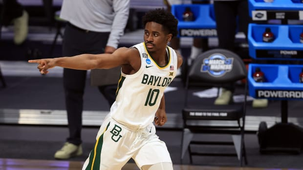 Baylor's Adam Flagler reacts after hitting a three