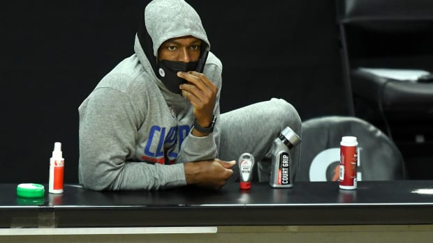 Mar 30, 2021; Los Angeles, California, USA; Los Angeles Clippers guard Rajon Rondo (7) looks on from the bench during the first quarter against the Orlando Magic at Staples Center. Mandatory Credit: Jayne Kamin-Oncea-USA TODAY Sports