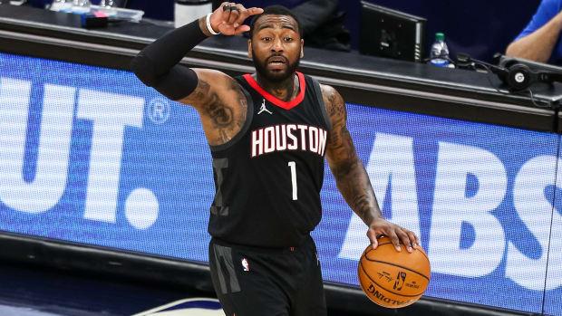 Houston Rockets point guard John Wall dribbles a basketball.