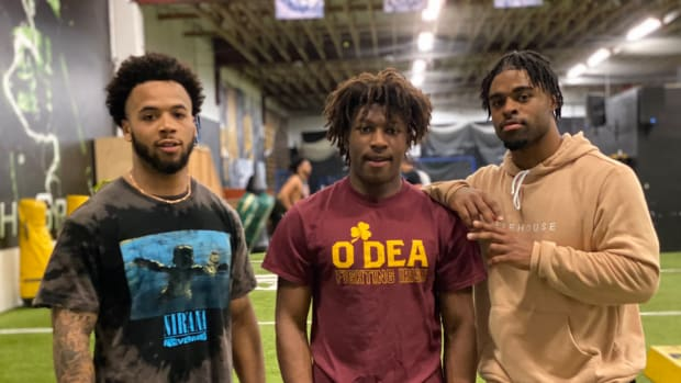 Myles Gaskin and Salvon Ahmed shared a moment with O'Dea freshman standout Jason Brown Jr.