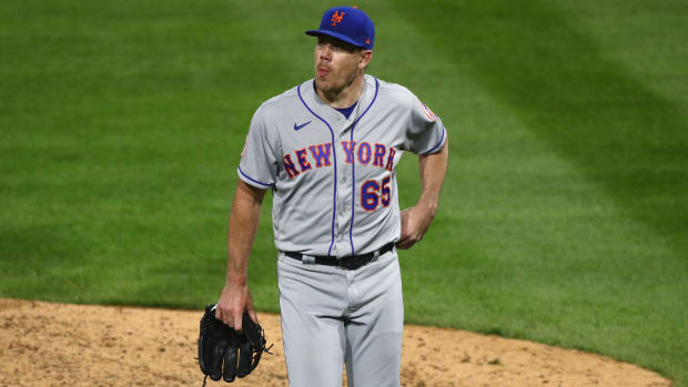 Trevor May walks off the mound after blowing the game for the Mets