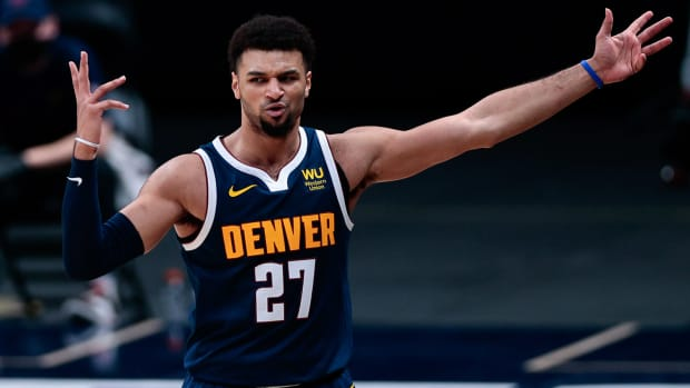 Nuggets guard Jamal Murray with his arms raised