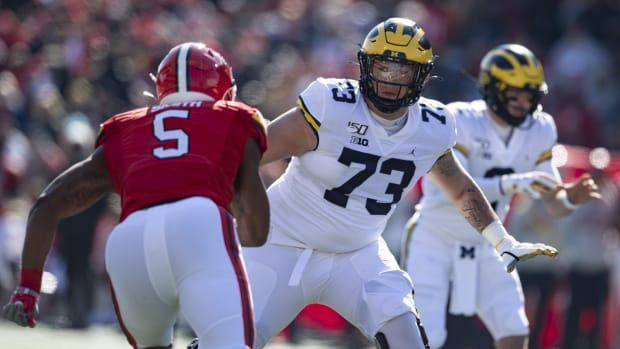 Nov 2, 2019; College Park, MD, USA; Michigan Wolverines offensive lineman Jalen Mayfield (73) blocks Maryland Terrapins linebacker Shaq Smith (5) during the first half at Capital One Field at Maryland Stadium. Mandatory Credit: Tommy Gilligan-USA TODAY Sports