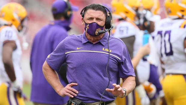 Nov 21, 2020; Fayetteville, Arkansas, USA; LSU Tigers head coach Ed Orgeron looks on during the first half against the Arkansas Razorbacks at Donald W. Reynolds Razorback Stadium.