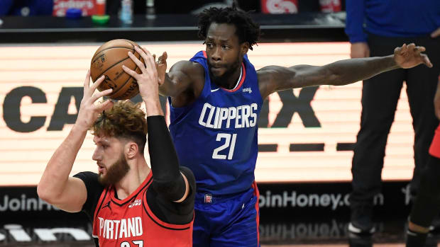 Dec 30, 2020; Los Angeles, California, USA; LA Clippers guard Patrick Beverley (21) tries to steal the ball from Portland Trail Blazers center Jusuf Nurkic (27) during the first quarter at Staples Center. Mandatory Credit: Robert Hanashiro-USA TODAY Sports