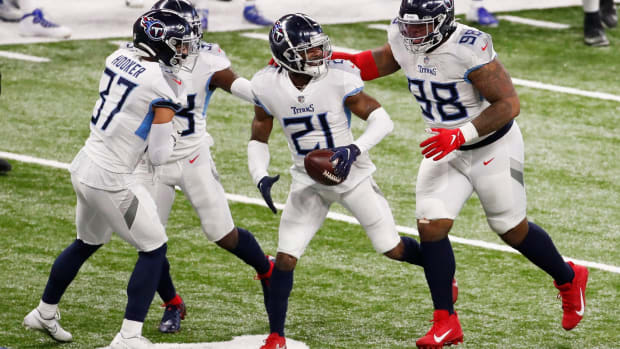 Tennessee Titans cornerback Malcolm Butler (21) celebrates an uncalled interception with teammates at Lucas Oil Stadium in Indianapolis, Sunday, Nov. 29, 2020. Tennessee Titans defeated the Indianapolis Colts, 45-26.