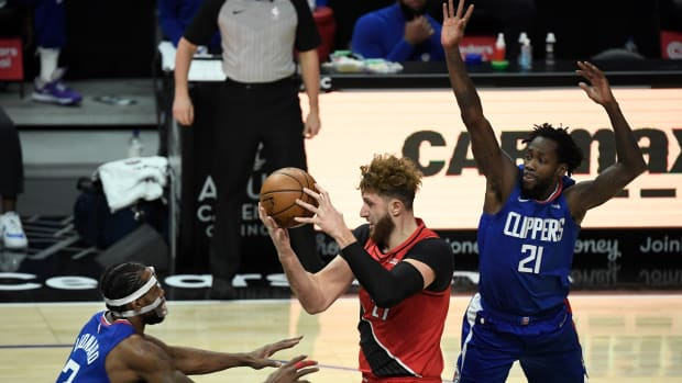 Dec 30, 2020; Los Angeles, California, USA; Portland Trail Blazers center Jusuf Nurkic (27) drives into the key defended by LA Clippers forward Kawhi Leonard (2) and LA Clippers guard Patrick Beverley (21) during the first quarter at Staples Center. Mandatory Credit: Robert Hanashiro-USA TODAY Sports