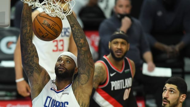 Apr 6, 2021; Los Angeles, California, USA; Portland Trail Blazers forward Carmelo Anthony (00) and center Enes Kanter (11) look on as Los Angeles Clippers center DeMarcus Cousins (15) goes up for a dunk in the first half of the game at Staples Center. Mandatory Credit: Jayne Kamin-Oncea-USA TODAY Sports
