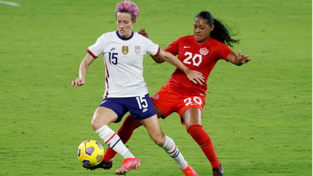Feb 18, 2021; Orlando, Florida, USA; United States forward Megan Rapinoe (15) and Canada defender Jayde Riviere (20) battle for the ball during the first half of a She Believes Cup soccer match at Exploria Stadium.