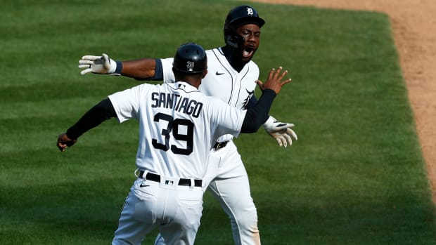 Apr 6, 2021; Detroit, Michigan, USA; Detroit Tigers center fielder Akil Baddoo (60) celebrates with first base coach Ramon Santiago (39) after hitting a walk off single to win the game in the tenth inning against the Minnesota Twins at Comerica Park.
