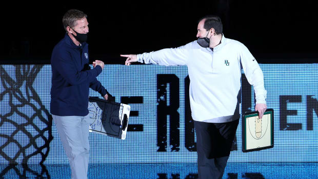 Mark Few and Scott Drew dressed in athleisure wear at the national title game