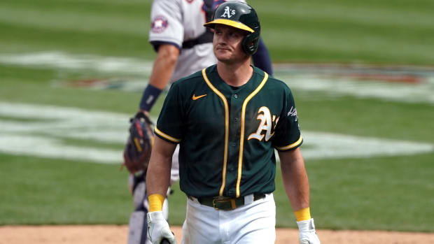 Apr 4, 2021; Oakland, California, USA; Oakland Athletics third baseman Matt Chapman (26) walks back to the dugout after batting during the sixth inning against the Houston Astros at RingCentral Coliseum.
